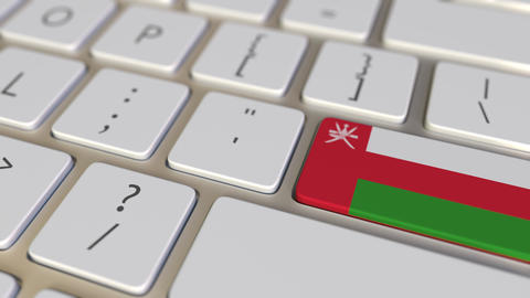 Key with flag of Oman on the computer keyboard switches to key with flag of Footage