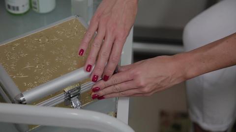 Professional beautician gets the device DermaPen Footage