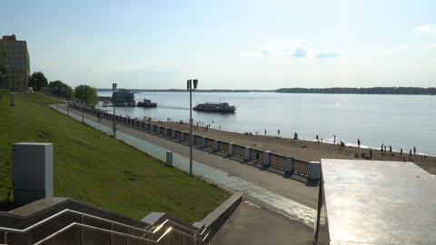 Volga river embankment in Samara. On the river floats a small ship Footage