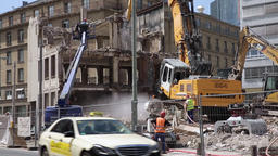 Building Demolition with Machinery in Action Live Action