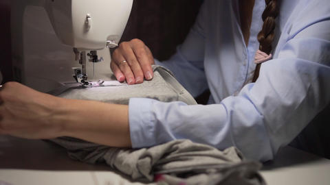 Woman's hands sewing with a sewing machine. Women's hands…, Live Action