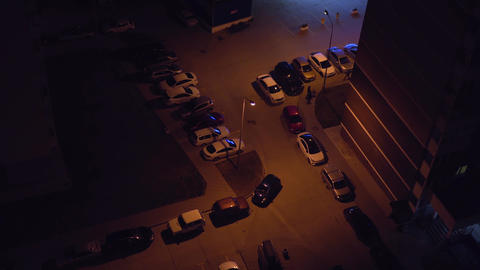 Top view of the parking lot from the roof of a skyscraper at night. Parking by Footage