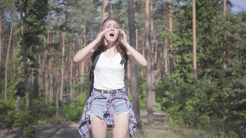 Portrait pretty scared young woman gets lost in the forest, she calling for the Footage