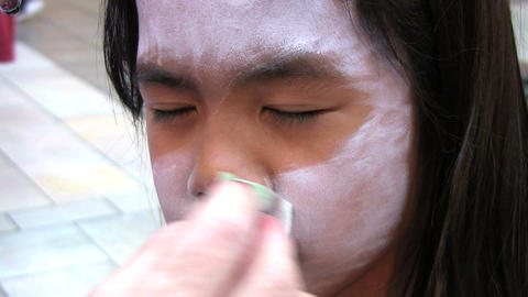 Applying Face Paint Stock Video Footage