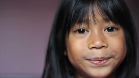 Asian Girl Wiggling Her First Loose Tooth Close Up Stock Video Footage