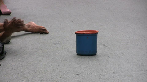 Beggar With A Blue Cup Stock Video Footage