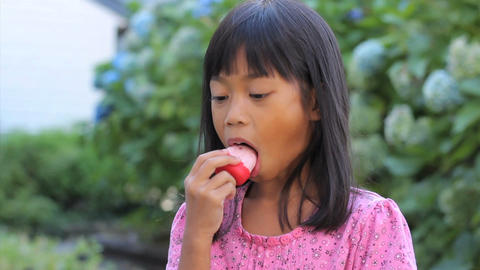 Cute Asian Girl Licking Her Popsicle Stock Video Footage