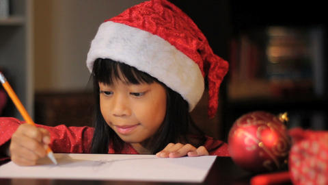 Cute Six Year Old Drawing Picture For Santa Claus Close Up Footage