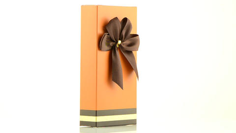 Orange box with gold bow Stock Video Footage