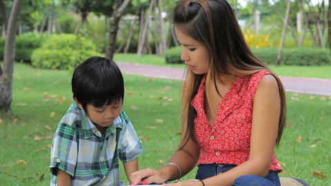 Asian Mom Teaching Son To Read Stock Video Footage