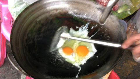 Cooking Eggs In A Wok stock footage