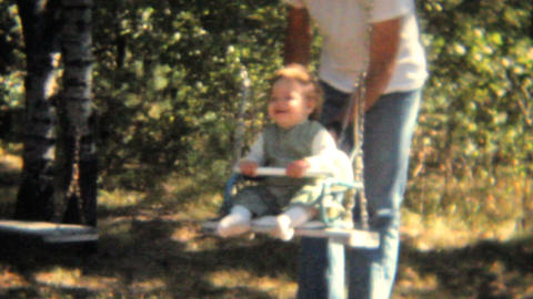 Dad Pushes Daughter On Swing 1968 Vintage 8mm film Stock Video Footage