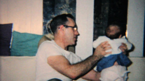 Grandfather Plays With New Granddaughter 1965 Vintage 8mm... Stock Video Footage