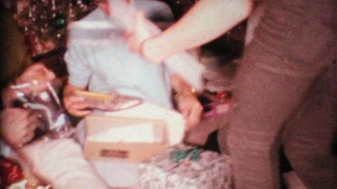 Man Gets Suspenders For Christmas 1967 Vintage 8mm film Stock Video Footage
