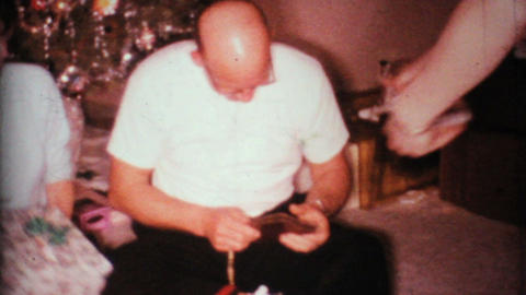 Man Gets Suspenders For Christmas 1967 Vintage 8mm film Stock Video Footage