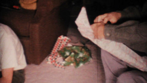 Old Man Gets Sweater For Christmas 1967 Vintage 8mm film Stock Video Footage