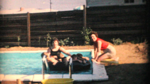 Young Moms With Kids Enjoy New Pool 1969 Vintage 8mm film Stock Video Footage