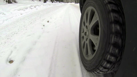 Driving by car on snowy suburb road 1 Stock Video Footage