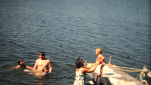Family Swimming Off The Dock 1968 Vintage 8mm film Stock Video Footage