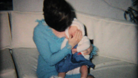 Young Mom Fussing Over Baby Daughter 1965 Vintage 8mm film Stock Video Footage