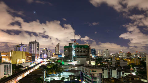 Timelapse - City at night with cloudscape under moonlight Stock Video Footage