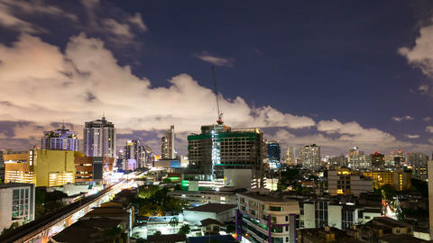 Timelapse - City at night with cloudscape under moonlight Live Action