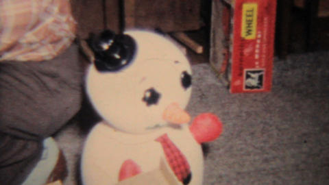 Baby Girl With Psycho Frosty The Snowman 1964 Vintage 8mm Film stock footage
