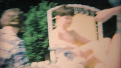 Dad Barbeques For Teenage Pool Party 1969 Vintage 8mm film Stock Video Footage
