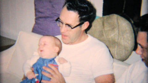 Grandfather Looking Tentative With New Granddaughter 1965... Stock Video Footage