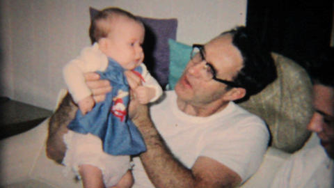 Grandfather Looking Tentative With New Granddaughter 1965 Vintage 8mm film Footage