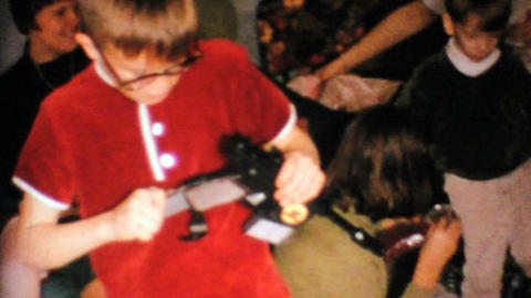 Little Boy Gets Gun For Christmas 1967 Vintage 8mm film Stock Video Footage