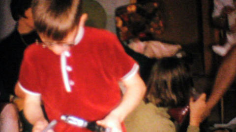 Little Boy Gets Gun For Christmas 1967 Vintage 8mm film Stock Video Footage