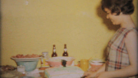 Teenage Girl Cuts Birthday Cake 1964 Vintage 8mm film Stock Video Footage