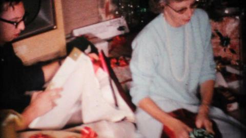 Woman Admires Christmas Presents 1967 Vintage 8mm film Stock Video Footage