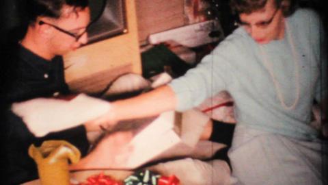 Woman Admires Christmas Presents 1967 Vintage 8mm film Footage