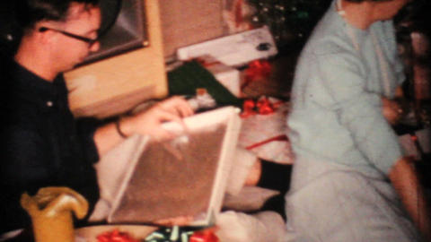 Woman Admires Christmas Presents 1967 Vintage 8mm film Stock Video Footage