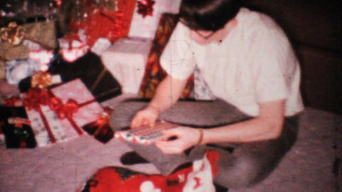 Young Man Gets Socks For Christmas 1967 Vintage 8mm film Stock Video Footage
