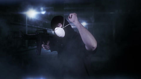 Masked Commando Man with Gun in Scary Alley 2 Stock Video Footage