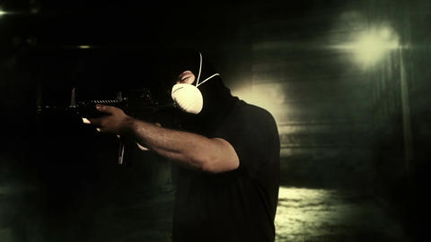 Masked Commando Man with Gun in Scary Alley 5 Stock Video Footage