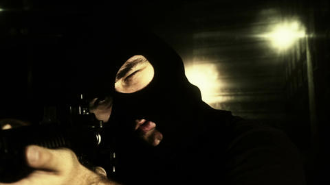Masked Commando Man with Gun in Scary Alley 17 Stock Video Footage