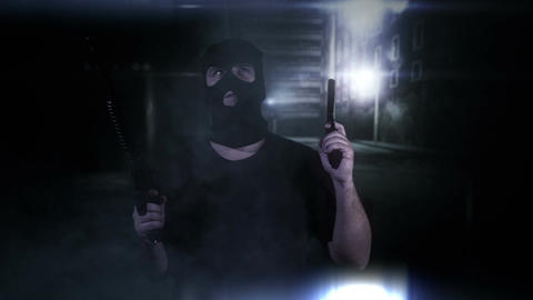 Masked Guard Man with Double Guns in Scary Alley 10 Stock Video Footage