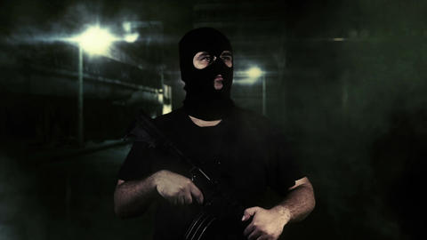 Masked Guard Man with Gun in Scary Alley 1 Stock Video Footage