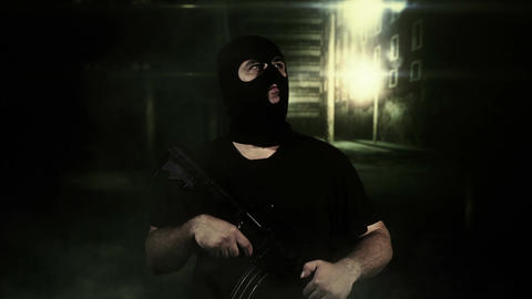Masked Guard Man with Gun in Scary Alley 3 Footage