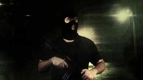 Masked Guard Man with Gun in Scary Alley 5 Stock Video Footage