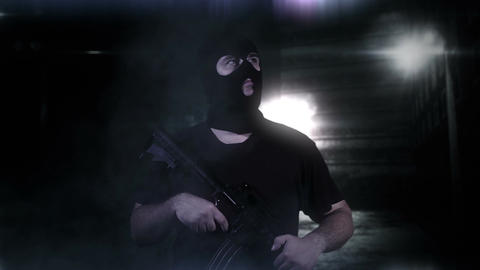Masked Guard Man with Gun in Scary Alley 6 Stock Video Footage