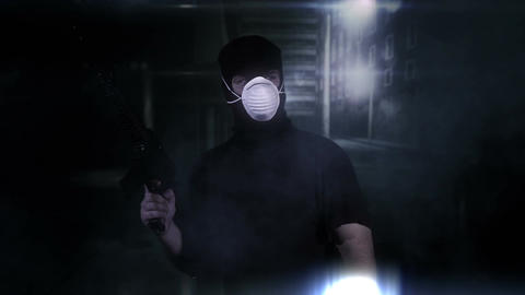 Masked Guard Man with Gun in Scary Alley 10 Stock Video Footage
