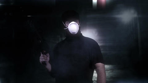 Masked Guard Man with Gun in Scary Alley 12 Stock Video Footage