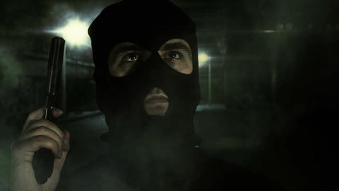 Masked Man with Gun in Scary Alley 1 Stock Video Footage