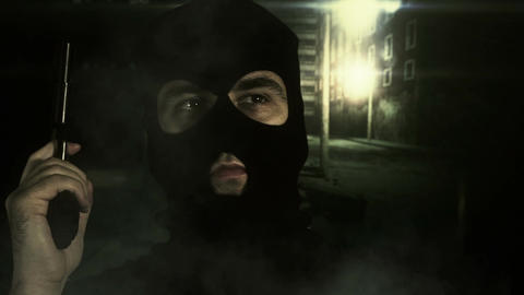 Masked Man with Gun in Scary Alley 3 Stock Video Footage