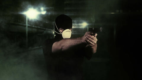 Masked Man with Gun Shooting in Scary Alley 1 Stock Video Footage